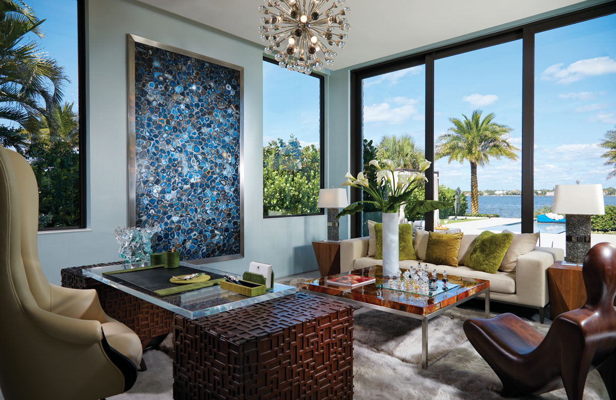 "In the study, ""Le Lotus,"" a lustrous, walnut wood figure that takes the form of a surprisingly comfortable modernist accent chair, is strategically positioned to enjoy views of the infinity edge pool and the Intracoastal Waterway beyond."