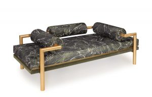"""Framed in painted brass and wrapped in a Pierre Frey faux marble print, the """"Trompe L'oeuil"""" sofa from HYDE HOUSE is sure to fool the eye. hydehouse.co.uk"""