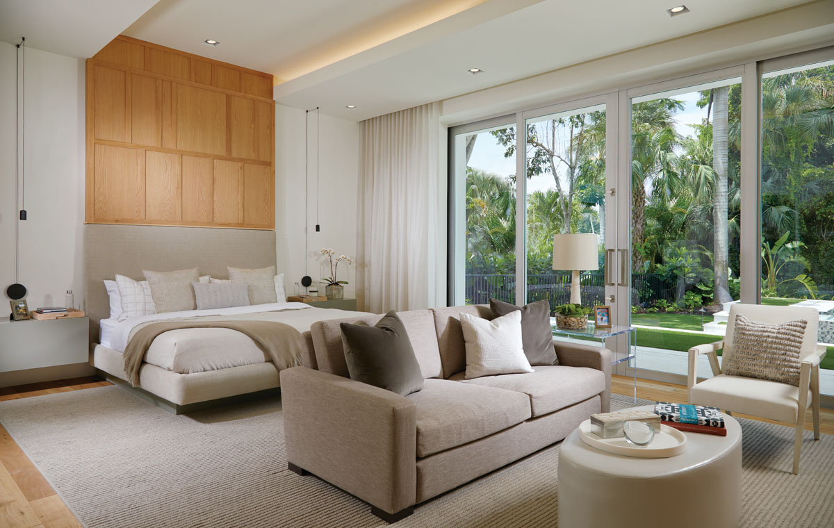 "Dressed in simple yet elegant linens, the custom-designed bed is flanked by Vibia's unusual light pendants that suspend above chests that appear to float. ""I wanted architectural lighting with long chords that can hang in any configuration,"" designer Jack Lonetto says. Couristan's light-toned area rug warms the private space."