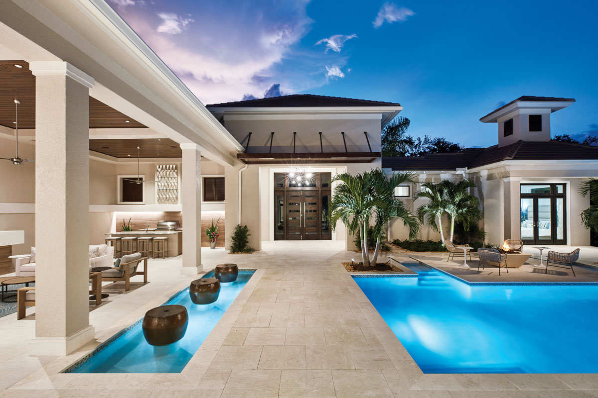 """""""I wanted people to say 'wow' from the minute they saw this house,"""" builder John McGarvey says. From the grand entrance and dramatic floor-to-ceiling windows to a central courtyard featuring an inviting outdoor living area, a shimmering pool and alluring fire bowls, this home is a stunning creation."""