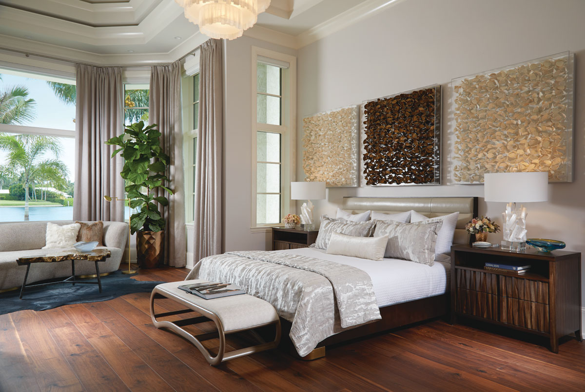 The master bedroom combines a push and pull of natural textures with quiet color. Parsons specified the bed designed by Jean Louis Deniot and had it upholstered in Moore & Giles' leather. Joseph Jesup-designed chests of zebrawood, a sculptural bench at the foot of the bed, and the wife's selection of Palecek's Lucite shadow boxes encasing wood leaf sculptures above the bed lend a cozy warmth.