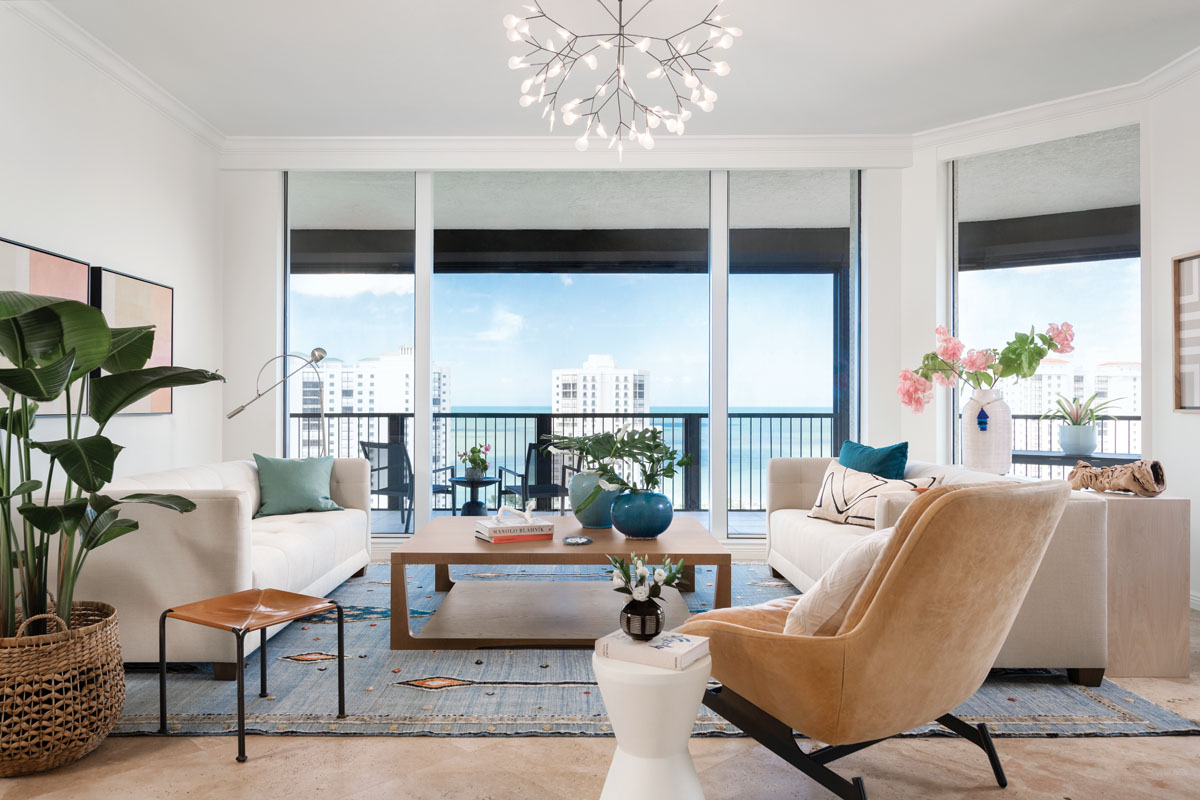 It's all about this corner unit's stunning city and ocean views — and the elements within. Colors in the living room pop with the sunburst hues in the art by Minneapolis artist Ellen Richman and ocean blues in the Moroccan area rug.