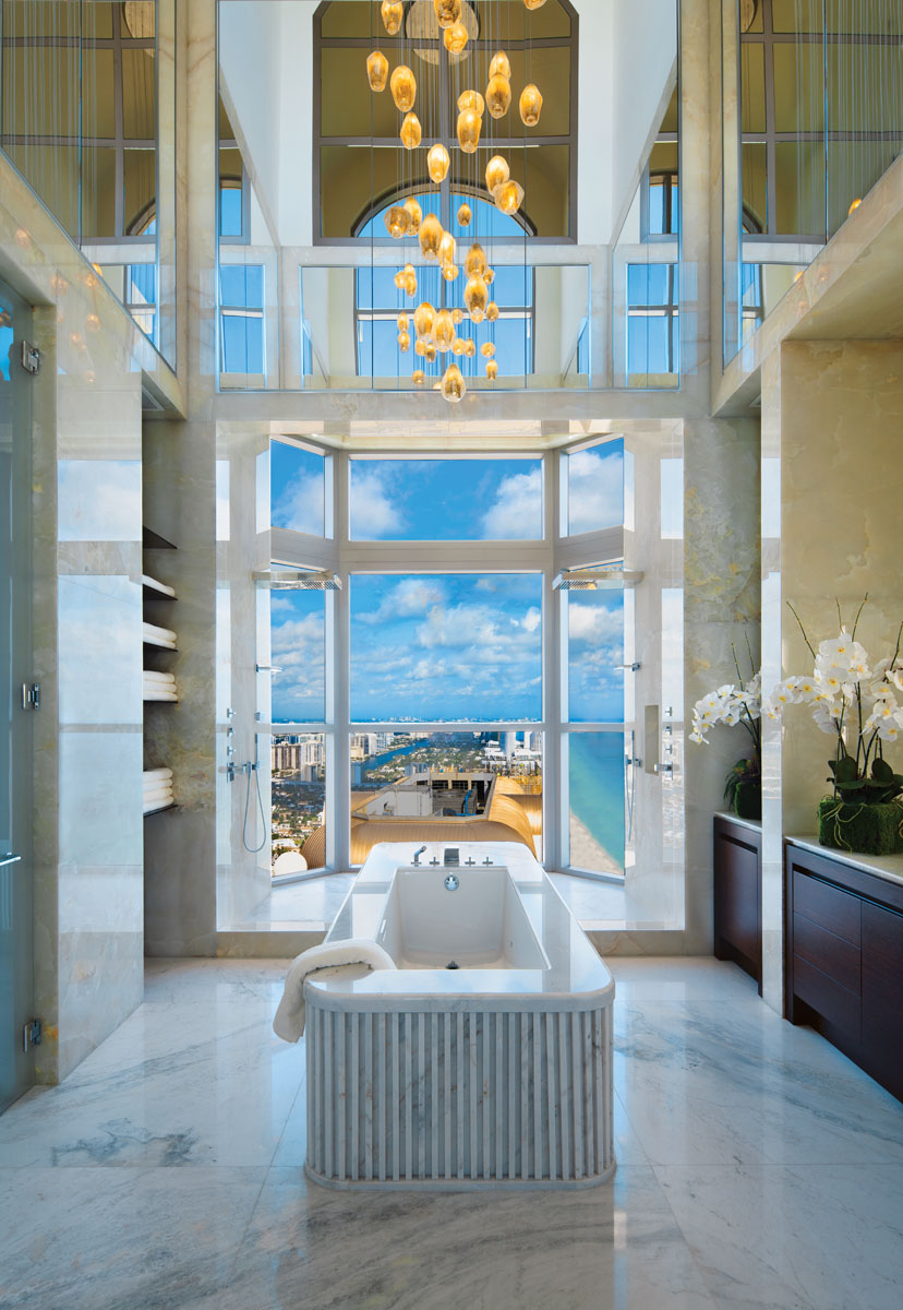 "Breathtaking views, a private terrace and custom furnishings from Fendi Casa complete the intimate scene, while white alabaster wraps ""her"" master bath in spa-like luxury."