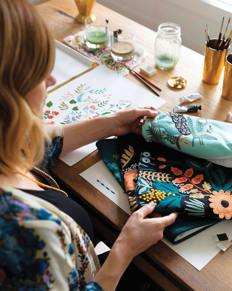 The Rifle Paper Co. x Loloi collection offers vibrant, new rug and pillow designs that integrate artist and Rifle co-founder Anna Bond's hand-painted gouache illustrations with Loloi's high-quality weaving processes.