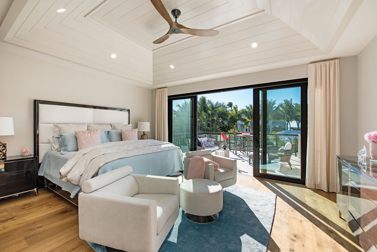 "Blue is also a dominant color in the master bedroom. ""When opening the sliding glass doors, you look straight at the pier: it is the best view in the house,"" the designer says. ""Making the interiors reflect the vistas is always a given."""