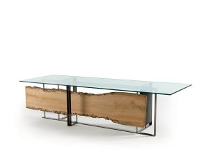 "Sculpted by the sea and returned to the land like a relic, briccole oak shapes the ""Cornice"" glass-topped table from RIVA 1920 with a symbolic narrative all its own. (riva1920.it)"