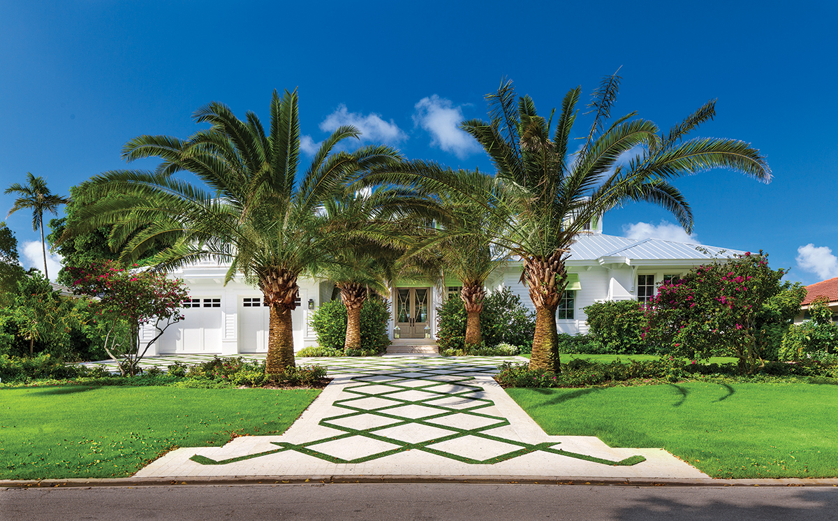 The home's landscaping by Architectural Land Designs is mostly freeform and informal, except for two Sylvester palms in the front and the grass-inlaid drive. It's very inviting — a primer for the vibrancy just beyond the front door.