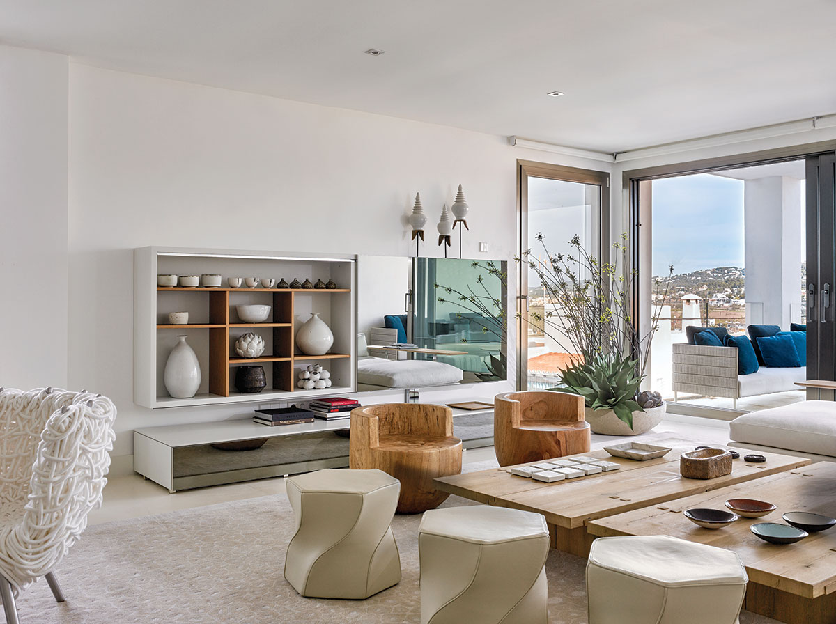 """I wanted everything white so that the bay would be the star,"" interior designer Juan Poggi says. ""I wanted the lighting in the room to change as the sun moved and the clouds shifted…"""