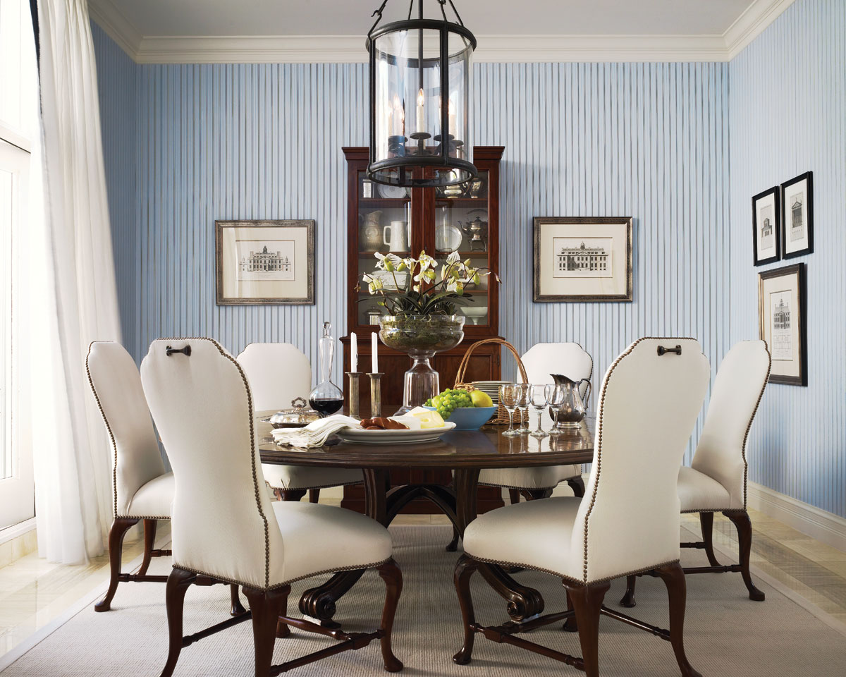 English etchings of 18th- and 19th-century architecture add a linear dimension to the dining room, while an antique English breakfront from Ray Hawkins Antiques provides interest in this intimate alcove.