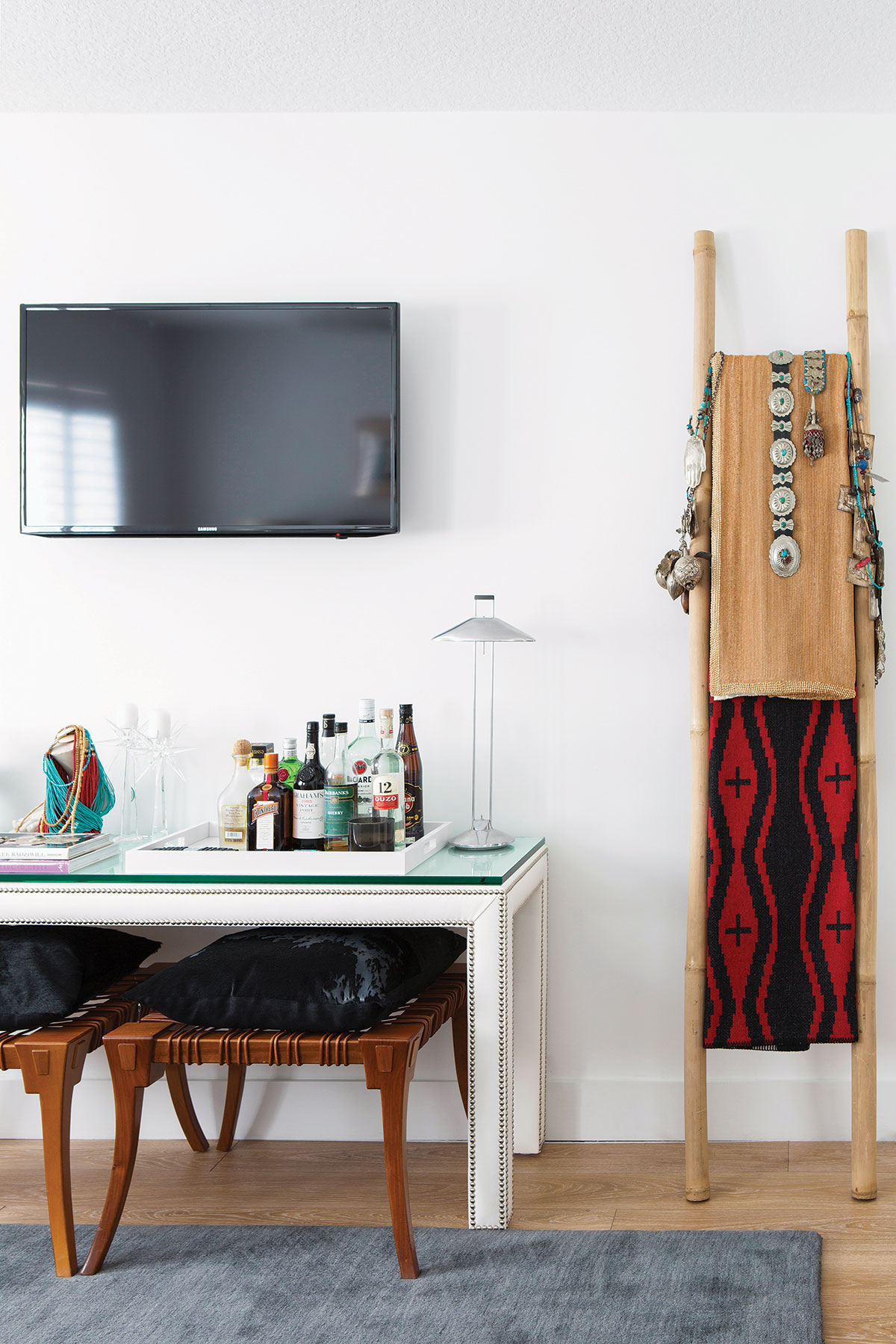 """I designed the bamboo ladder in the guest room with wood beads, spiritual offerings, a Navajo belt and metal objects from Brazil, Greece and Afghanistan,"" designer Stavros Garger says."