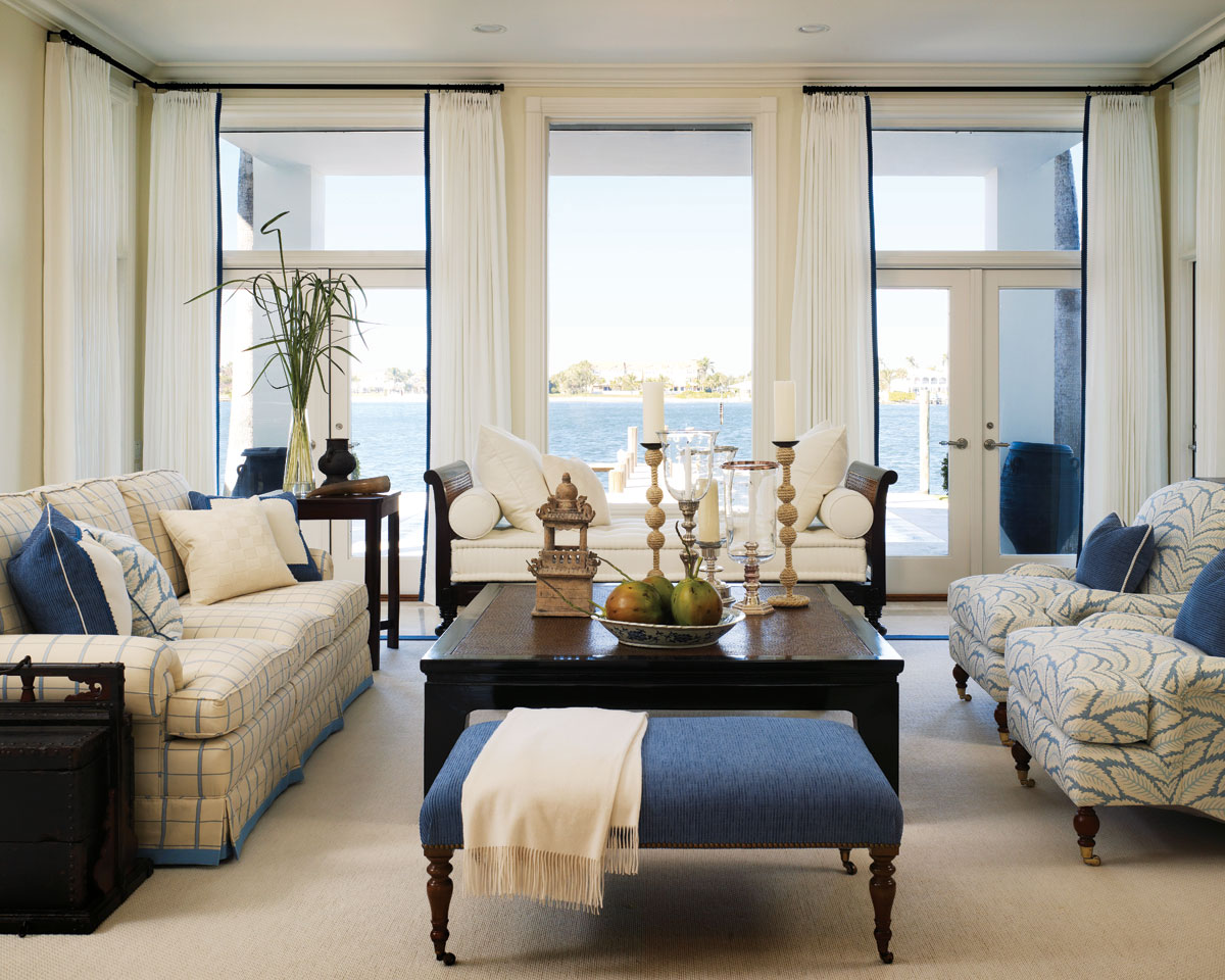 Picture-perfect, a divan from Robert Leighton takes center stage in the family room, where comfortable furnishings sport a more casual tone dressed in breezy cottons and linens.