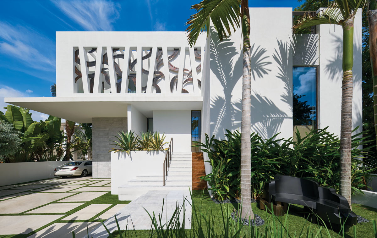 Los Angeles artist Zach Harris collaborated with the architect and the owner to mint the facade of the home to its formal entrance. Angled columns intertwined with serpentine vines sum the yin and yang aesthetic at play; and for passersby, the sculpted piece presents the gift of public art.