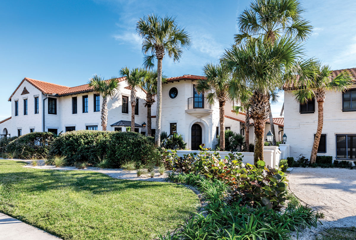 The renovated exterior of this historic residence in Neptune Beach takes its cues from the original Mediterranean Revival-style home constructed in 1931. New waterproofed brick veneer matches the old sand-lime brick that had deteriorated beyond repair, and stained mahogany doors emit an air of Old Florida elegance.