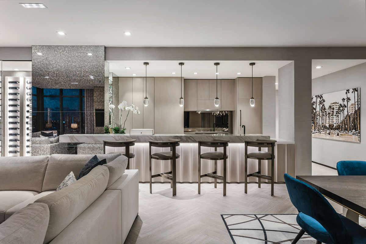 """Cabinetry by Wambia Woodwork; Interlude Home's """"Darcy"""" bronze barstools from Curated Living; Ochre's """"Celestial Pebble"""" glass orbs from David Sutherland."""