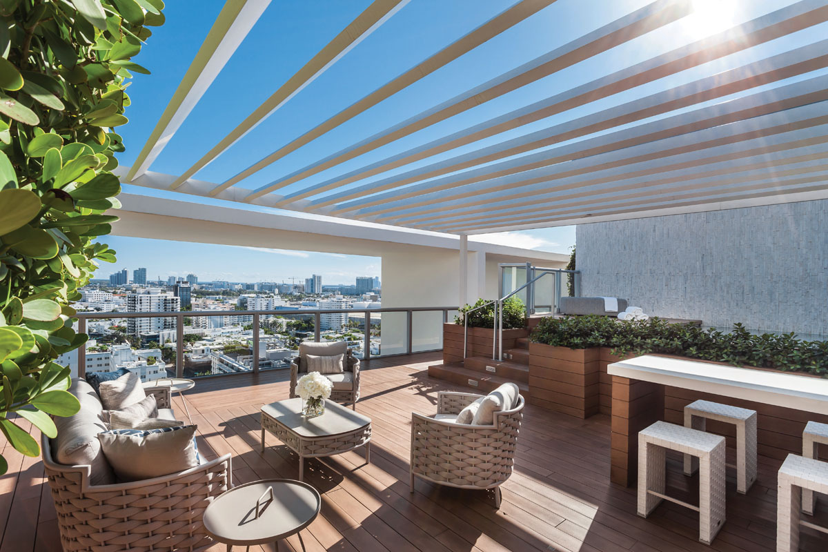 Woven-rope furnishings from Couture Jardin offer a nautical flavor on the rooftop terrace.