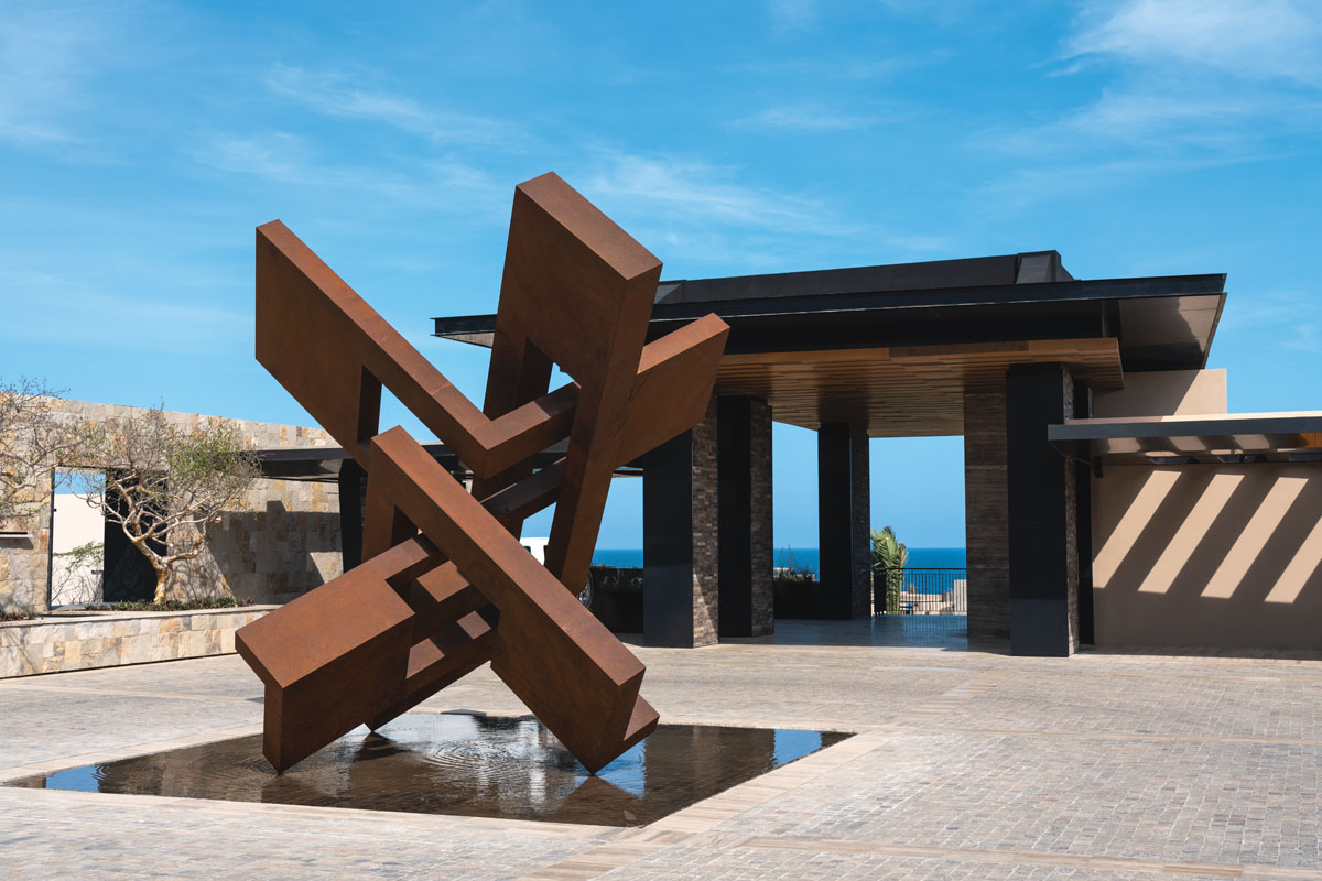 A corten steel sculpture by Arturo Berned welcomes travelers in the arrival pavilion.