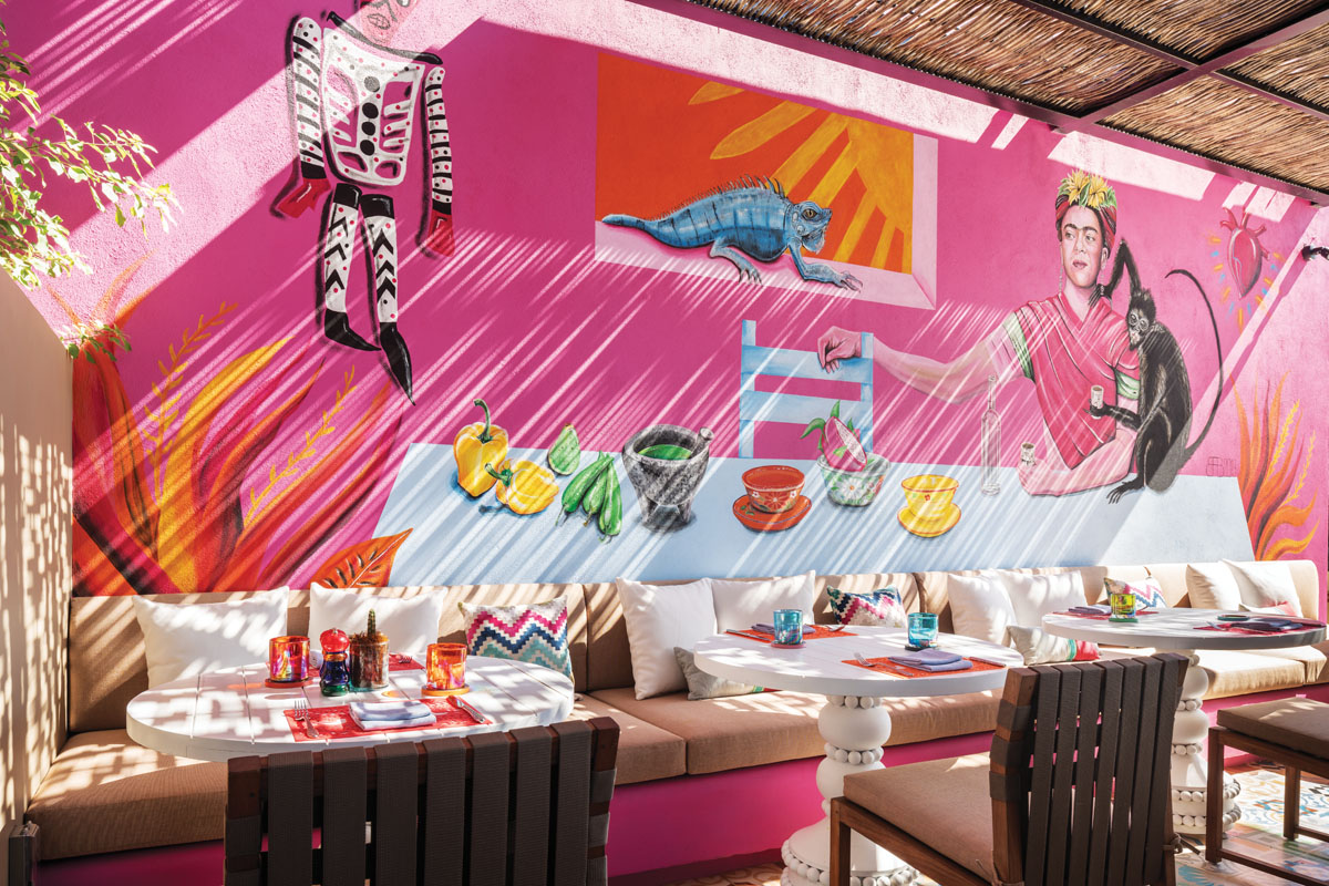 "El Barrio, the Mexicans' word for ""neighborhood,"" features murals by local artists and traditional Mexican textiles. Executive chef Rodrigo Torres traveled throughout Mexico to source the colorful tableware."