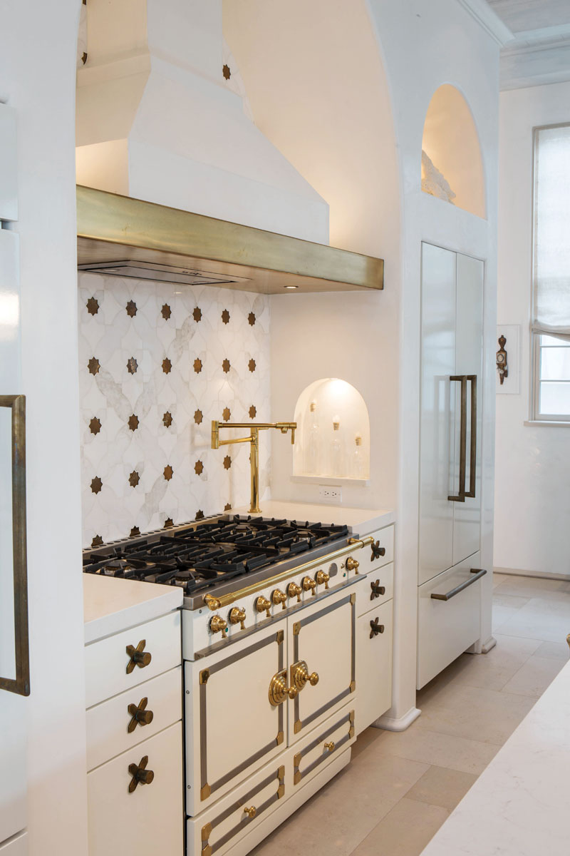 The kitchen's back wall appears to float beneath the beams as Sicis marble sparkles with little stars of Murano glass.