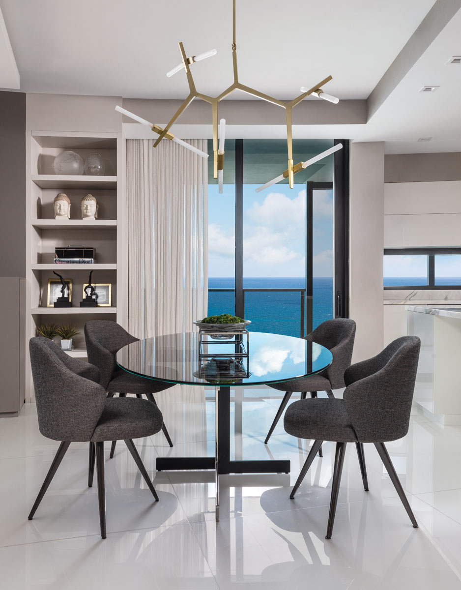 Minotti's dining ensemble circles the casual eating area, Wall Boutique's gossamer sheers.