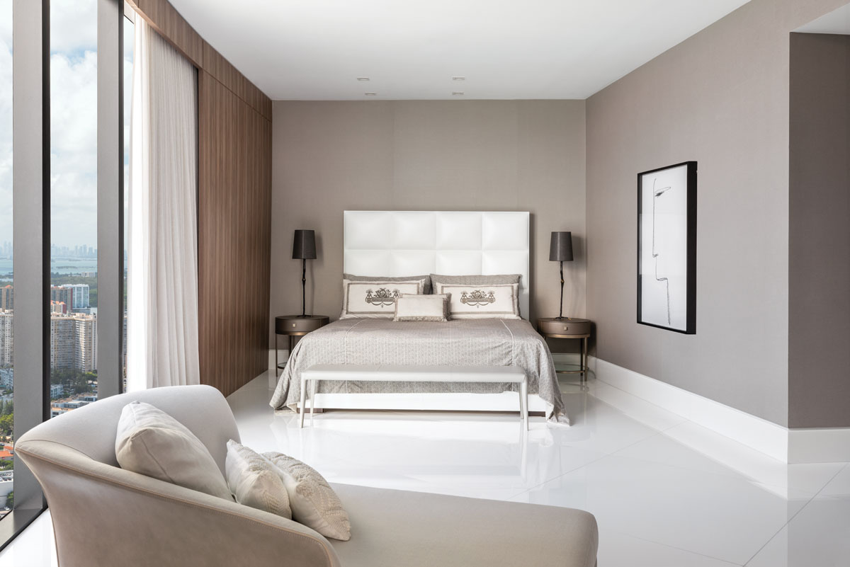Fendi Casa bed; DWR's sleek, leather-clad bench; chaise from Artefacto creates a cozy seating area. Mothé chose a minimalistic black and white piece from Roberta Schilling.