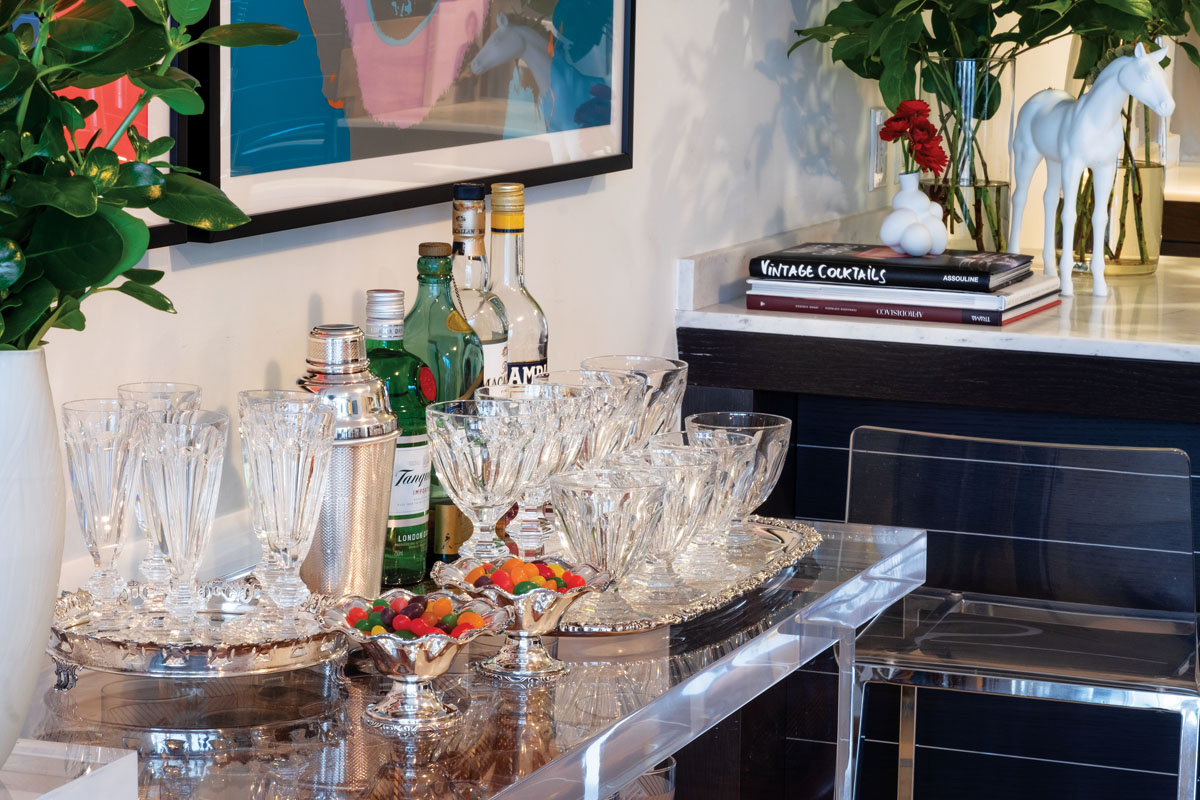 "Vintage crystal from Baccarat holds its own atop the bar as it dazzles in the evening light. ""I love the classic look of Baccarat,"" the fashion designer says."