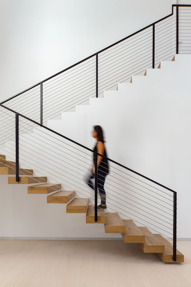 """The stairway is one of the home's most beautiful features,"" architect and interior designer Stephanie Halfen says. ""It is incredibly delicate with such a sensual outline that it truly becomes a work of art."""
