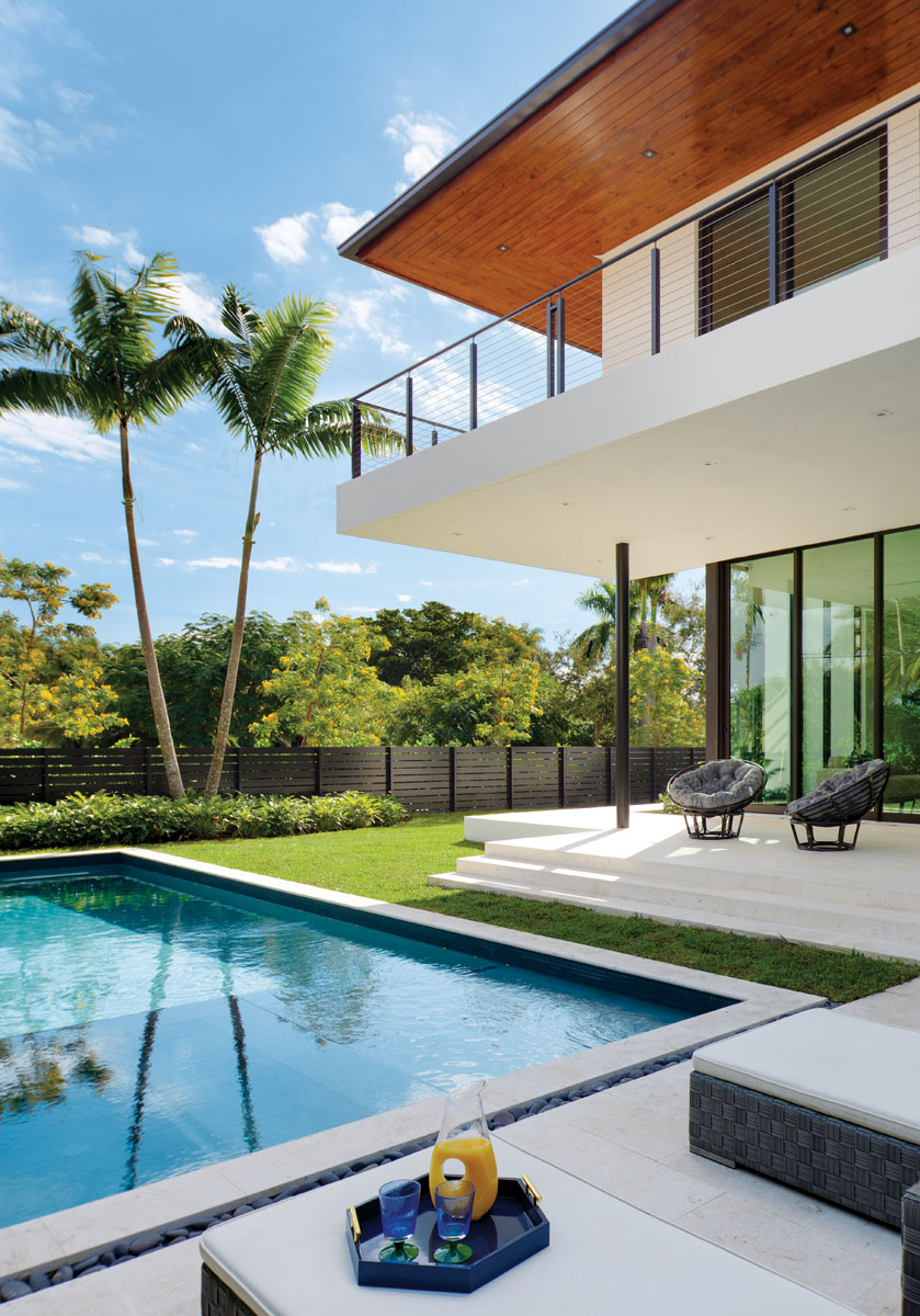 """Taking advantage of the home's location, the outdoor area offers a generous backyard, an inviting pool and spacious exterior living spaces,"" architect and interior designer Stephanie Halfen says."