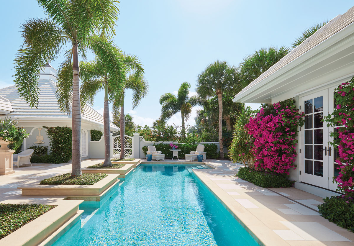 Anchored by a gated Chippendale entry and guest house, this 1960s home on John's Island in Vero Beach, Fla., comes alive with magenta bougainvillea blossoming from trellised walls.