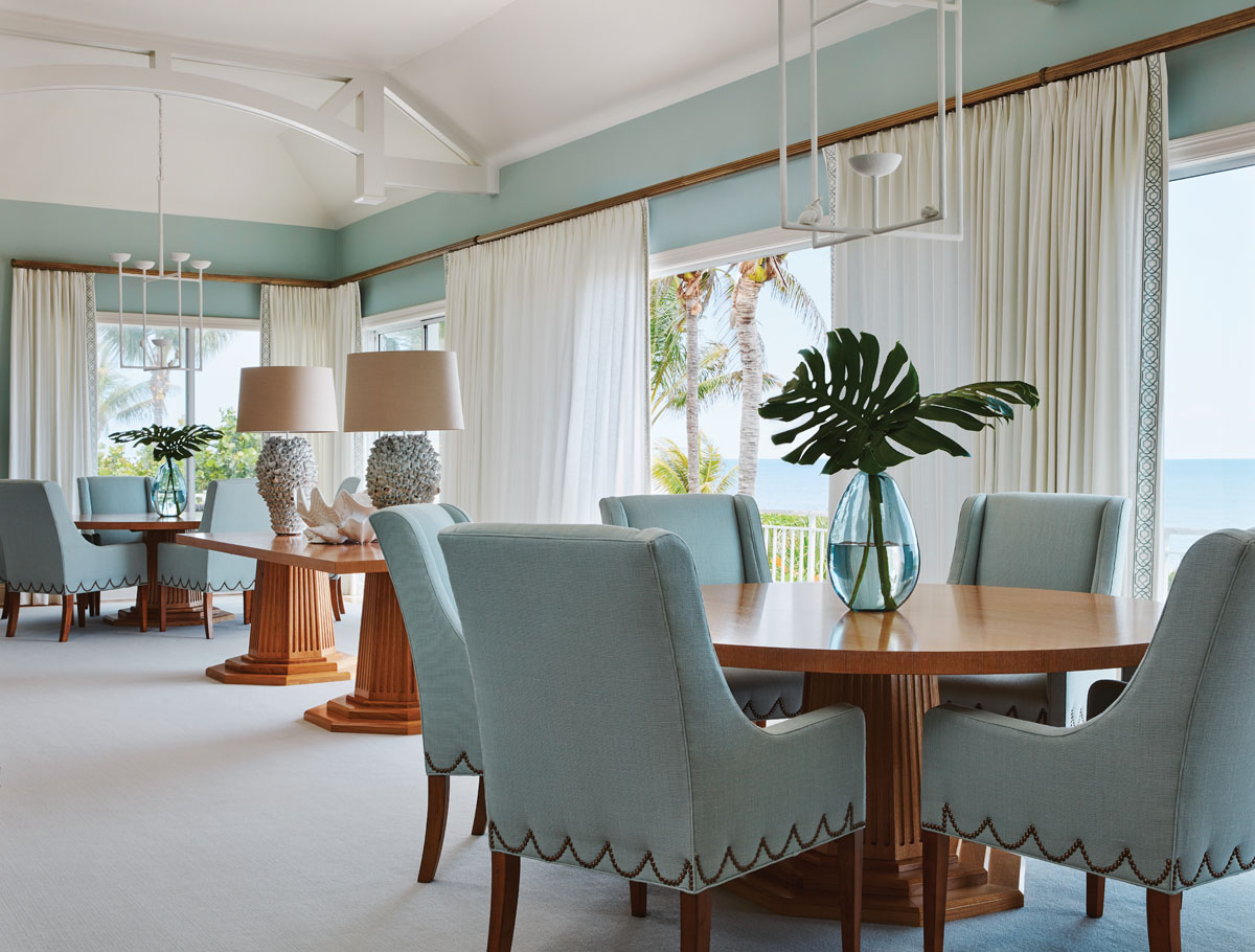 Circa's table lamps on the sideboard, Mecox Gardens' oversized lamps atop the center table and a pair of custom Demiurge chandeliers add shimmer to the expansive oceanfront space.