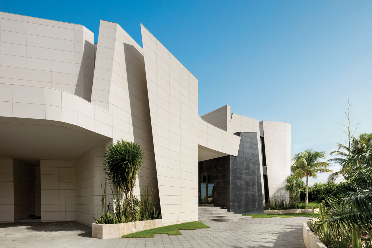 Designed by architect Joaquín Torres with unabashed modernity, sweeping stone planes and angles set this 11,000-square-foot house apart.