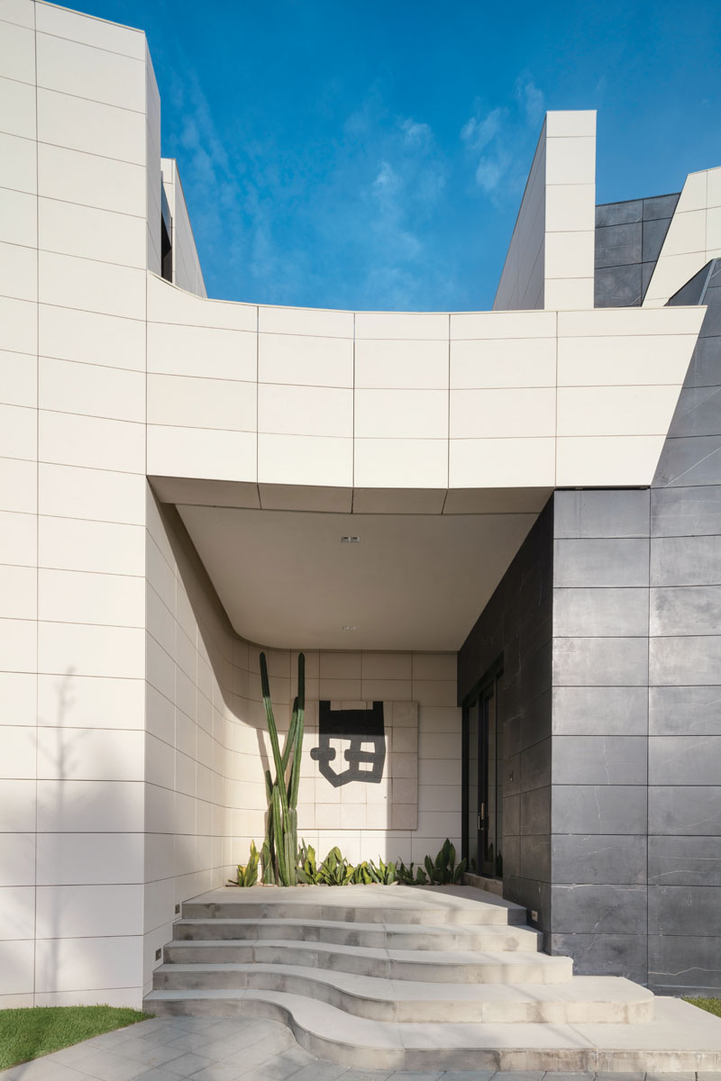Work of Spanish sculptor Eduardo Chillida mount the entry wall in prelude to the museum-like grandeur inside.