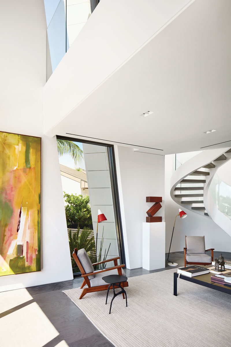 """A large Helen Frankenthaler abstract oil and an eye-catching """"Z-shaped"""" sculpture across the room."""