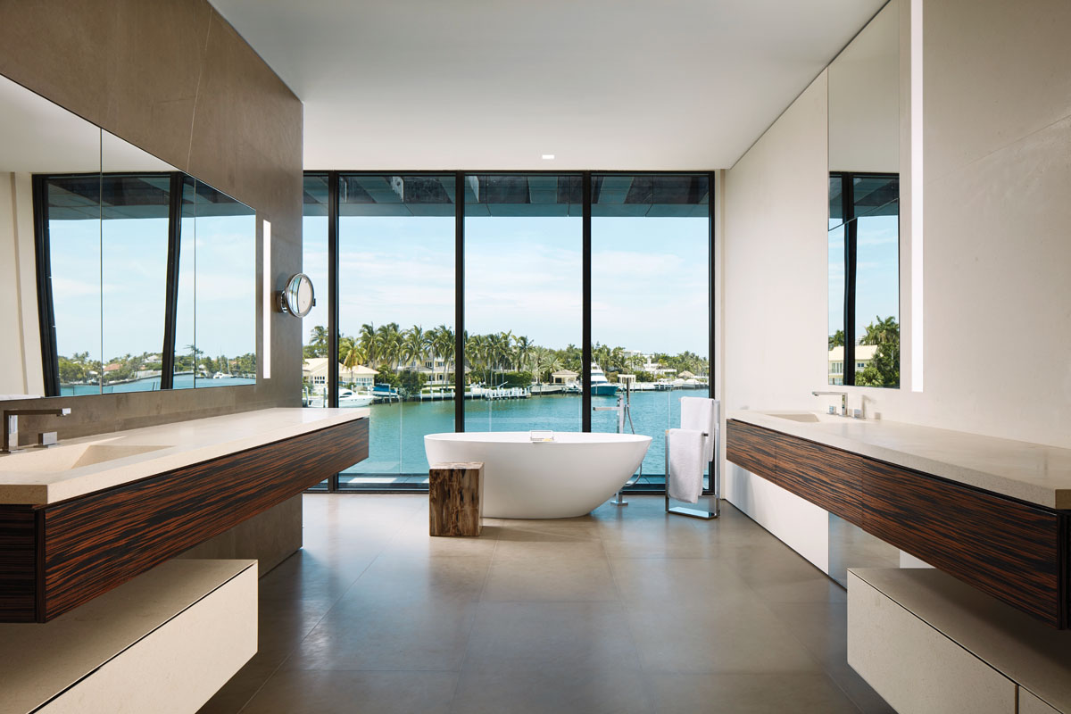 An artistic eye may see the cubist lines of the spare master bath, its walnut veneers shimmering in honeyed grains. Instead of draperies or obvious shades, each room has electric blinds that offer privacy and summer shade.
