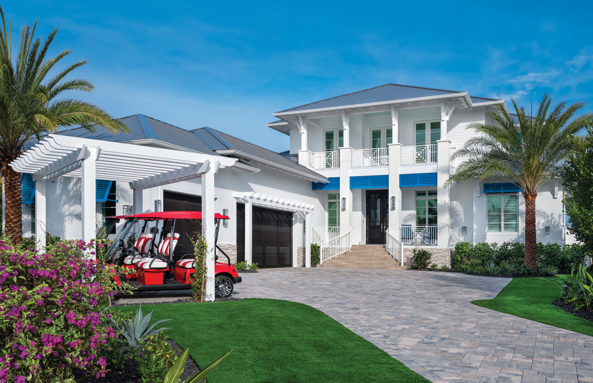 This 6,700-total-square-foot home brilliantly recalls the West Indies with its crisp whites and blues, and Bermuda-esque roof lines. The pergola houses the homeowners' red-and-white striped caddies — ready to go at a moment's notice.