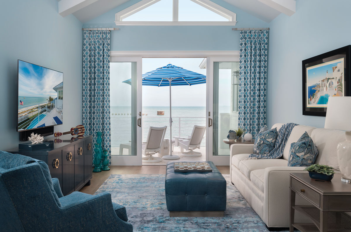 A nod to the Caribbean comes with the vaulted ceiling line and clerestory window of the private den. Luxurious furnishings from Cabana Coast offer the perfect spot to enjoy nightly sunsets. With a turn of the head and a few hours, a sunrise will appear at the entrance.