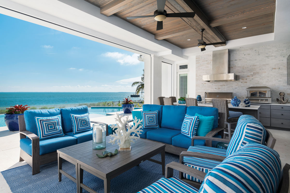 The homeowners' love of entertaining can be accommodated on the loggia that does not stray from the aqua, blue and navy hues used throughout the interior. The coffered wood ceiling is as elegant as those inside and the limestone paving as long-lasting.