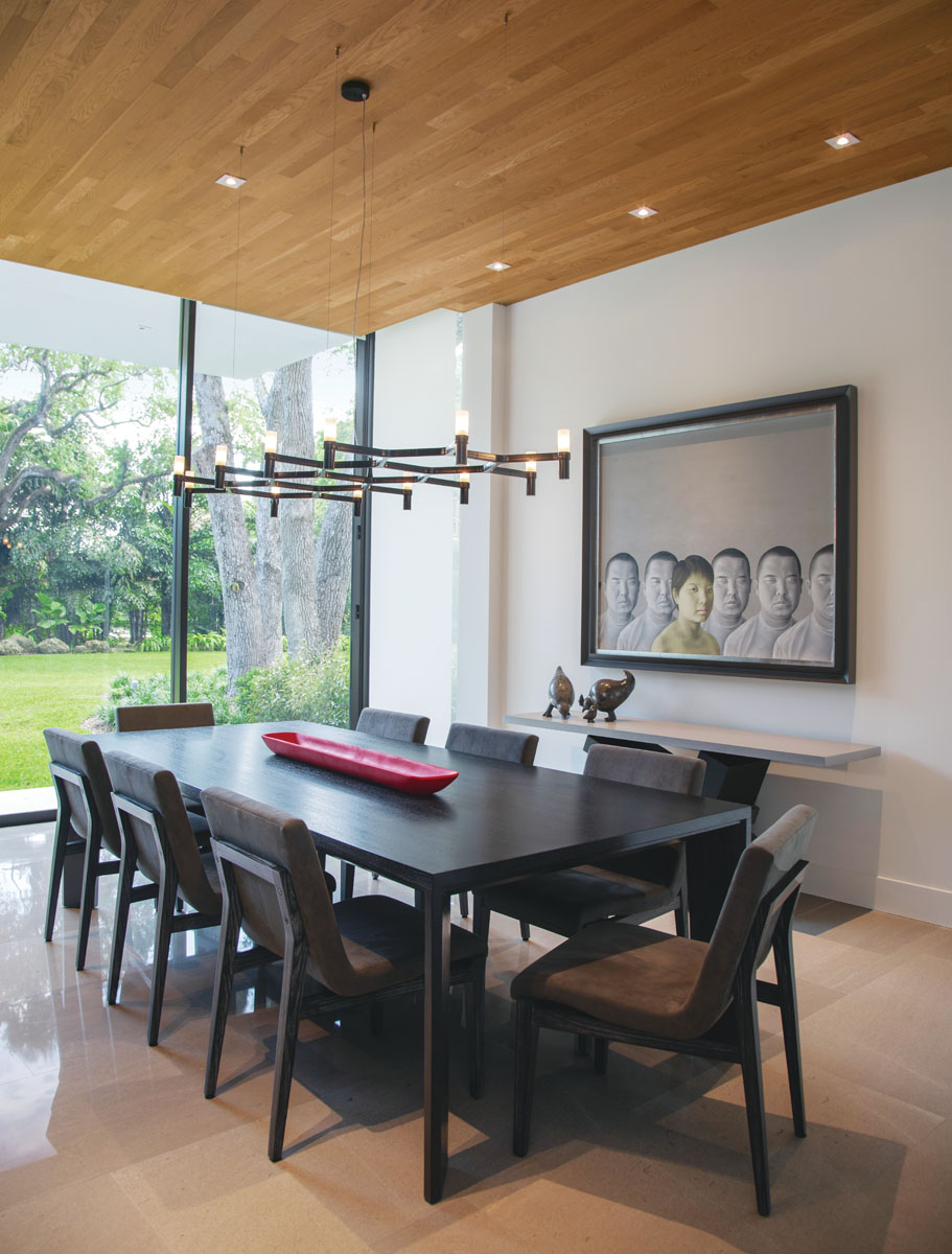 The family enjoys early morning breakfasts and midday fare seated at Eurocraft's walnut table in the casual dining area. Artist Chen Yu's impassive figures line the wall above Noir's metal and wood console.