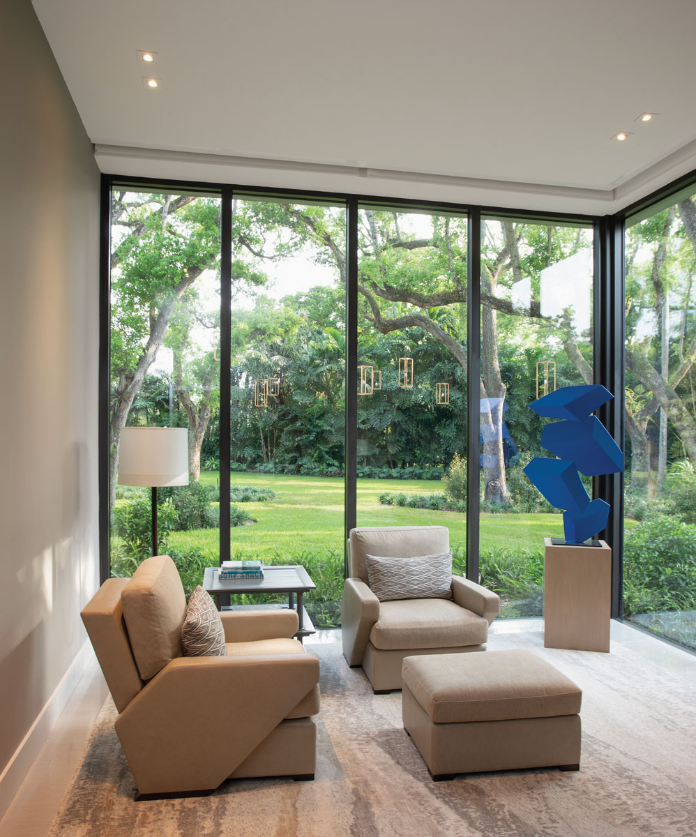 Capturing picturesque garden views through expansive panels of glass, the husband's study is a quiet place of refuge for reading, thinking and observation.