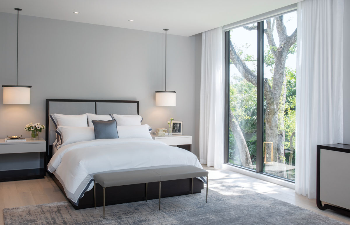 Soaring above the mass of the cantilevered patio roof, the master suite is surrounded by glass balustrades.