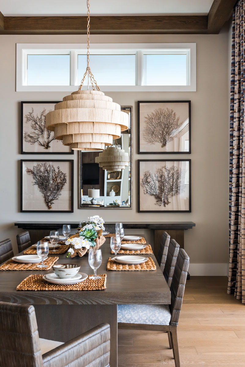 Palecek's tiers of finely woven abacá rope circle soft light around the dining room, where Vanguard's ash wood table takes center stage. Stacked sea fans create a sense of symmetry above the stepped cantilever form of Theodore Alexander's console wrapped in a curly maple veneer.