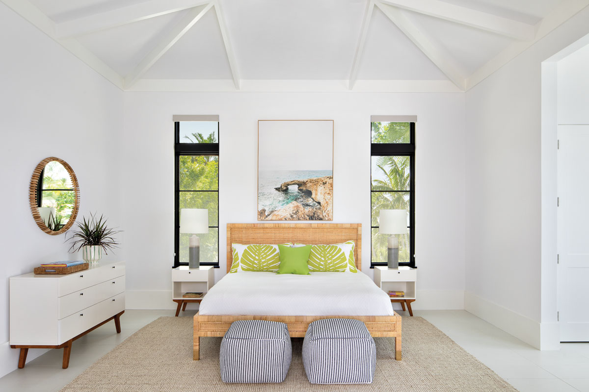 The guest house is awash in the tropics with a master suite that exudes casual comfort. Serena & Lily's wicker bed pairs with West Elm's chest and bedside tables to create an unencumbered ambience punctuated by pops of green.