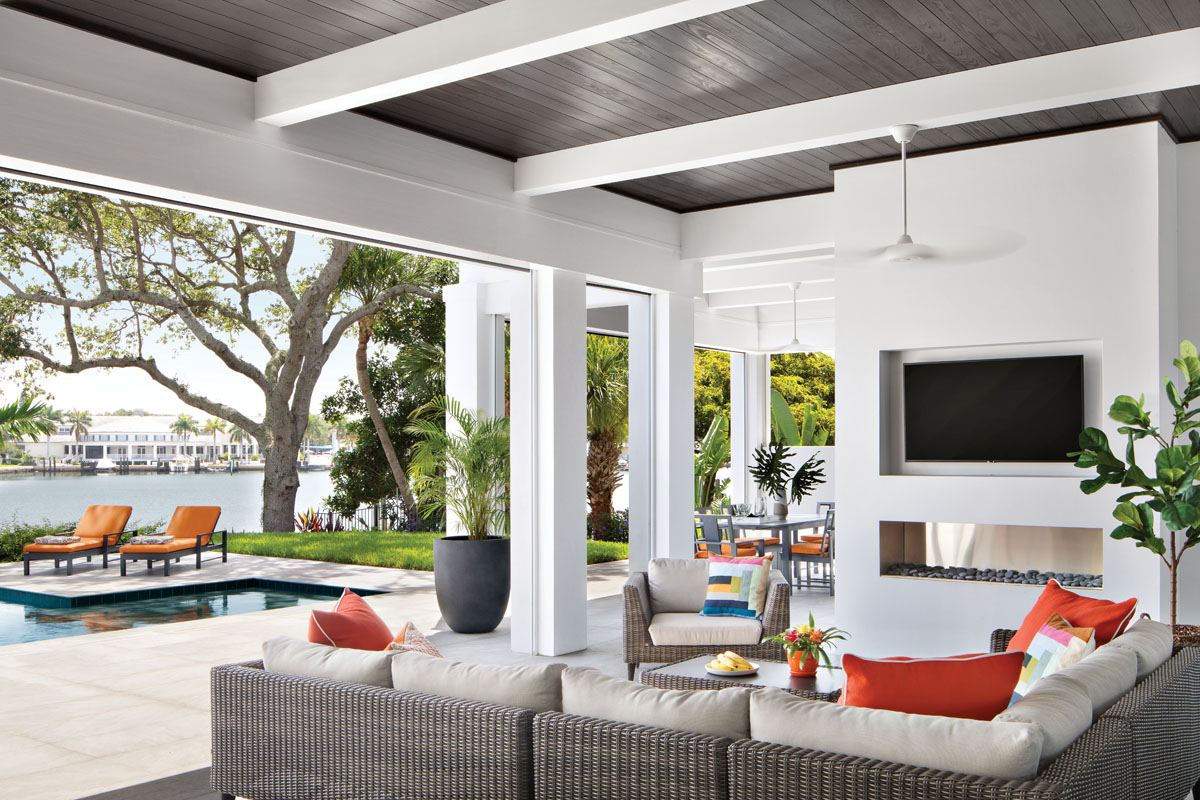 The loggia is warmly modern styled with West Elm's hearthside social setting, where family and friends gather for open-air fun. Restoration Hardware's dining ensemble easily seats the party overflow.