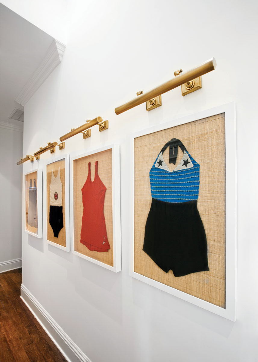 The hallway repeats the fun, water theme with more framed swimsuits.