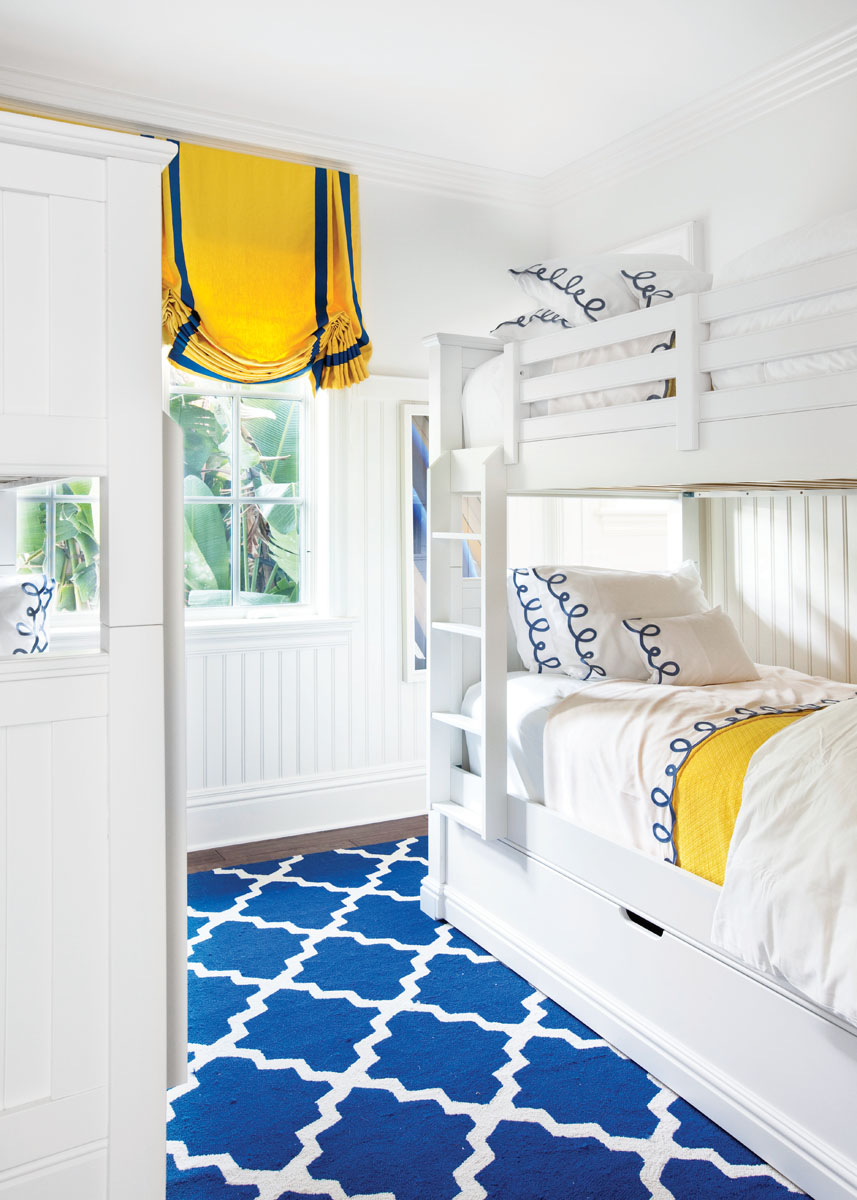 In the children's room, the yellow window treatment matches the blanket, radiating the best in Florida living.