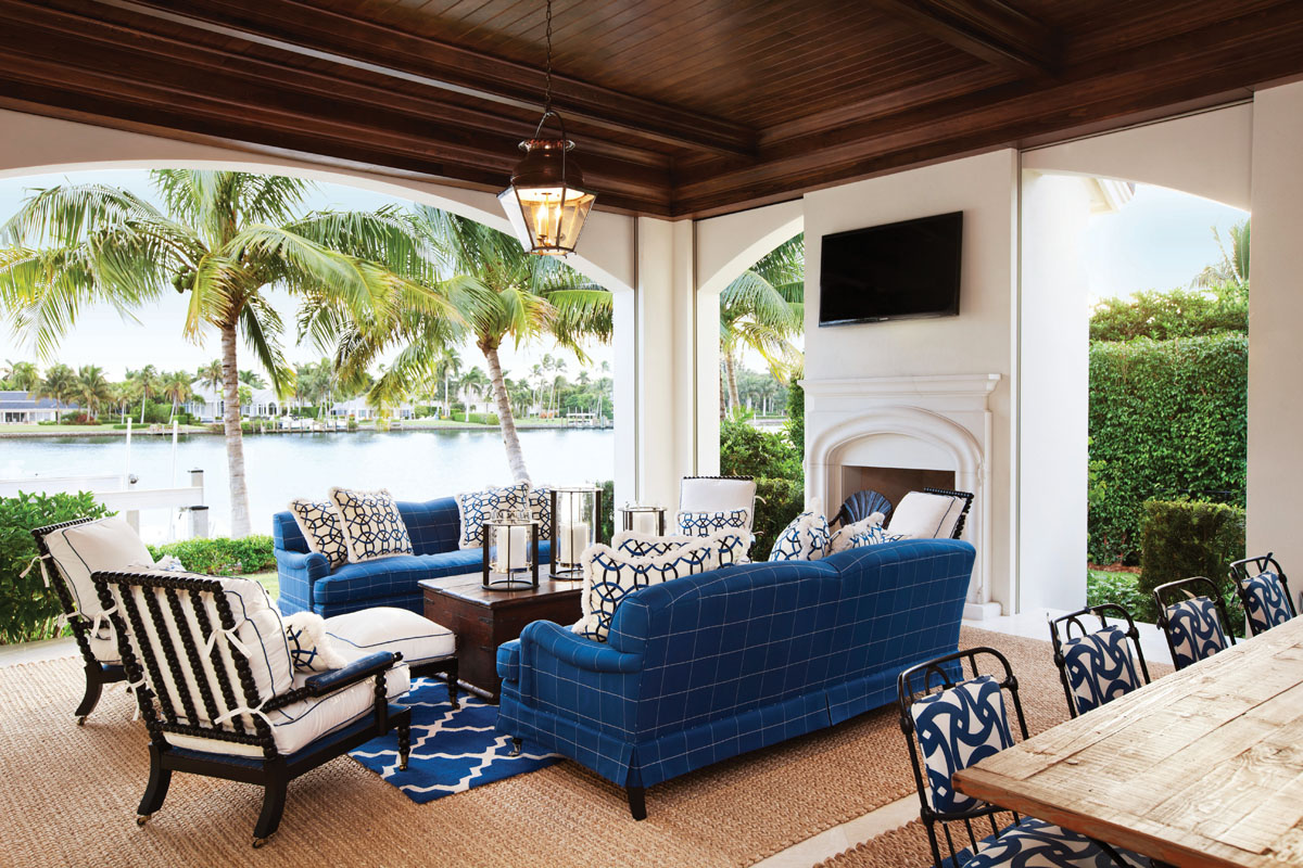 "On the loggia, Winters designed the deep blue couches in Romo fabric from Holly Hunt because the color looks beautiful in the southern light. ""The colors of the furnishings have to work visually with the light, which is so unique in Florida,"" Winters says."