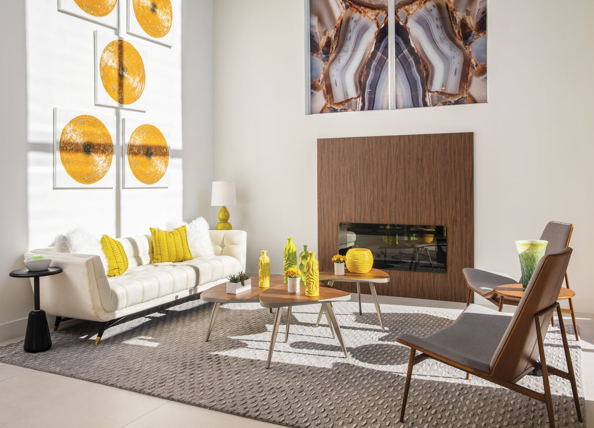 Circa 1960s, a cluster of walnut tables from Modani Furniture centers the living room with a retro feel. The linen-tufted sofa is casual yet stylish, while Modloft's midcentury chairs exude refined style.