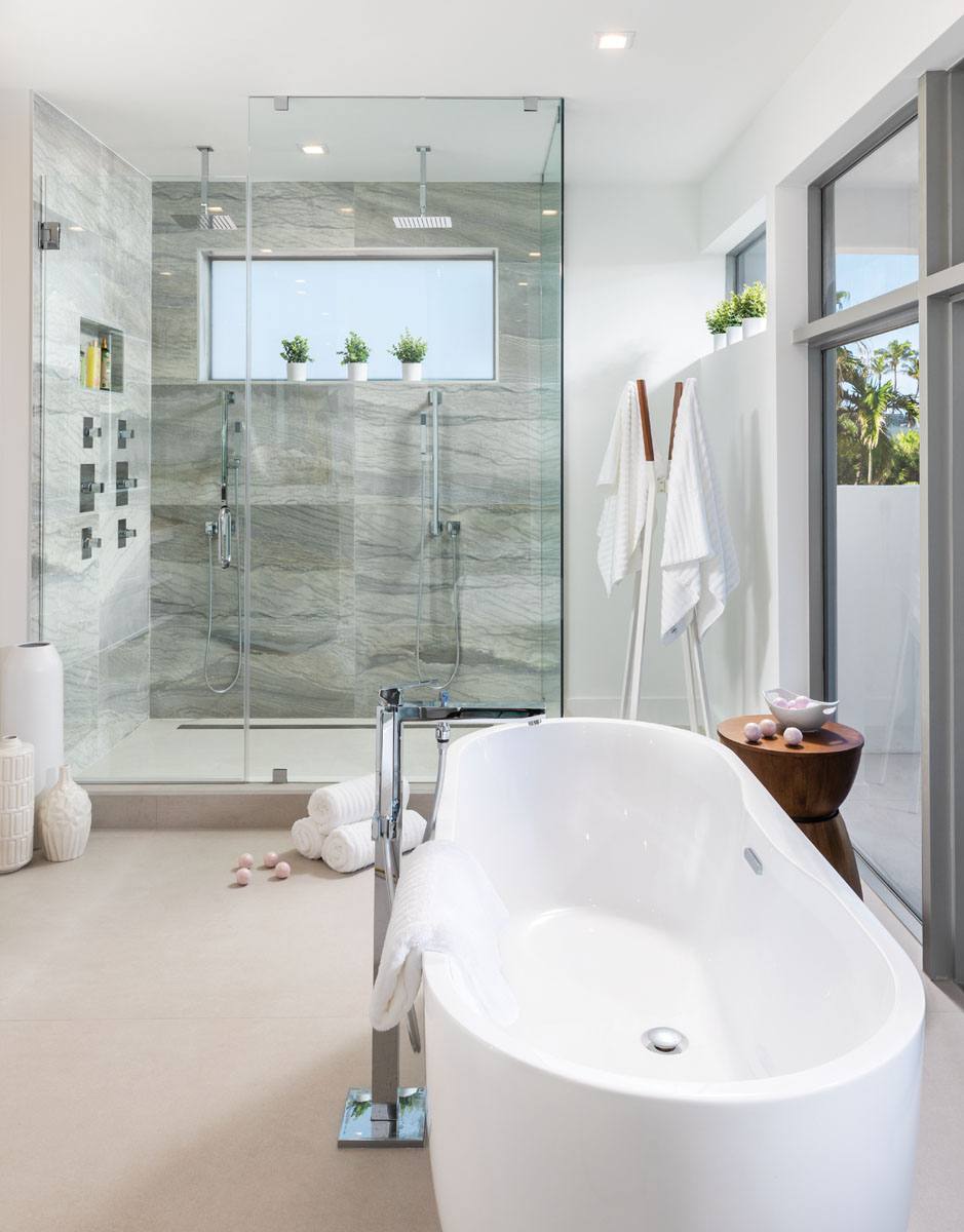 Modern elements in a relaxing environment pay tribute to the quintessential spa with an oval-shaped, freestanding tub from Ferguson and a shower outfitted with all the bells and whistles.