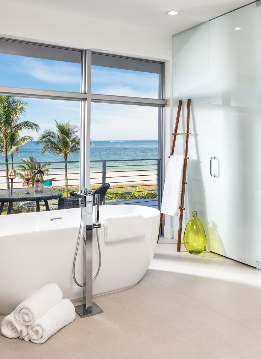 Ultra-sleek, the master bath is situated to take advantage of sprawling water views.