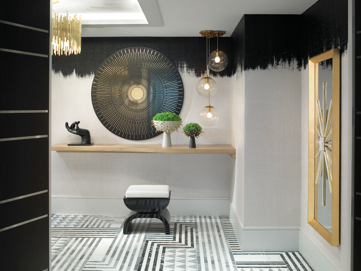 "Doors open to a foyer that dazzles with a splash of Art Deco and midcentury glam. ""You only get that first impression once,"" the designer says. ""We really wanted a bit of drama, so we created a jewelry box effect in the condo's entry."""