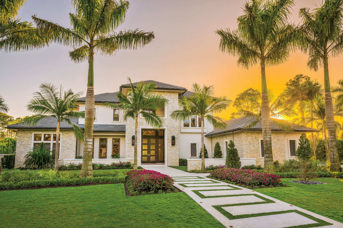 Situated amid lavish foliage, this light-filled, outwardly Mediterranean-style residence gleams against the tropical sunset. A long stone walkway cuts through the pristinely manicured grounds of the front entry in prelude to the extraordinary vistas awaiting beyond.